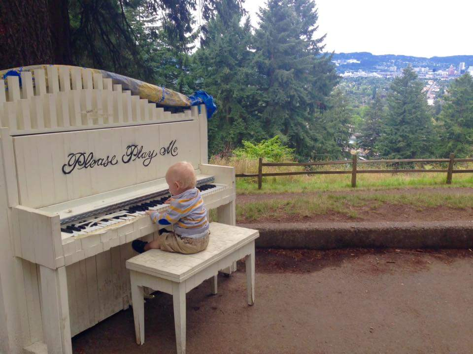 Piano playing baby in the woods
